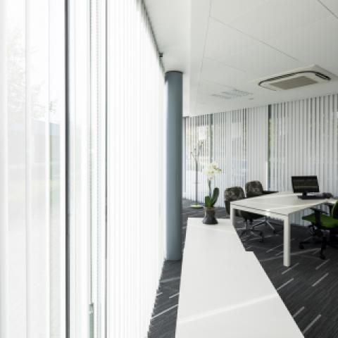 Perforated vertical synthetic blinds